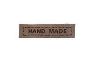 Cotton label 57x10 mm.